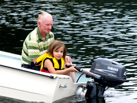 My Dad teaches Amy to use an outboard motor for the first time.