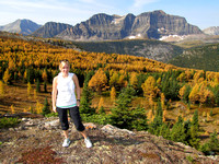 My sister Keri poses in front of the most amazing stand of Larches I have ever seen. The Monarch is the dominant peak behind her.