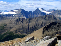 Ipasha Peak, Mount Merritt, and Mount Cleveland tower above Ptarmigan Wall. Cleveland is Glacier National Park's highest mountain.