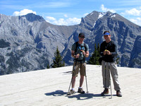 Nick and Dakota take a quick break on the helipad with Grotto Mountain directly above them. They were both great company and did awesome on this trip!
