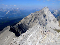 This shows the rest of the connecting ridge to Mount Pocaterra. Kananaskis Lakes are on the left with the highest peak in the haze being Mount Sir Douglas.