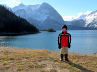 Riley looking exceptionally happy despite the cold October temperatures. Behind him are Upper Kananaskis Lake and Mount Sarrail.