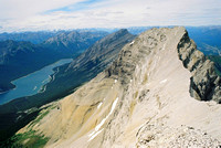 Mount Lougheed's north peak as seen from the true summit. Spray Lake and Big Sister can be seen in the distance.