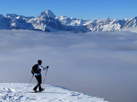 Mike gets ready to descend back into the clouds. Mount Assiniboine is directly above him.