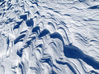 I believe these formations are called Sastrugi. This was some of the most intricate patterns I have ever seen on the snow.