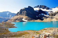 "An early morning view of the ""glowing"" waters of Caldron Lake with  Peyto Peak in the background."