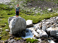 Riley poses near the creek where everyone enjoyed fresh ice cold meltwater directly from a nearby snowpatch.