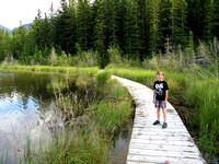 Riley walks along the floating bardwalk on the west end of Middle Lake.