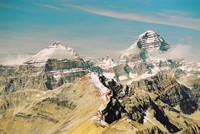 Eon Mountain and Mount Assiniboine tower over Red Man Mountain.